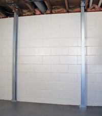 A foundation wall anchor system used to repair a basement wall in Spangle